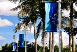 Coral Bay banners on the light poles at the North Bay Drive entrance.